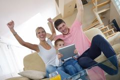 Family at home using tablet computer Royalty Free Stock Photo