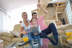 Family at home using tablet computer Royalty Free Stock Images