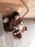 Family homeless. Homeless woman holding a child sleeping in the street. Photo taken in New Dheli - India