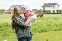 Family on horse farm Royalty Free Stock Photo