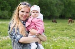 Family at horse farm Stock Photography