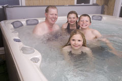 Family in hot tub. A family sitting and having fun in the hot tub stock photo