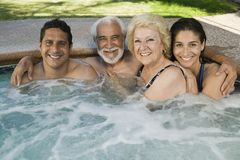 Family in hot tub portrait. Royalty Free Stock Image