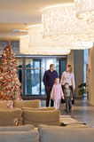 Family in the hotel. Happy family walking at foyer in the modern hotel Royalty Free Stock Photography