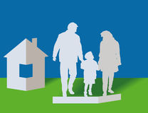 Family and house. Silhouettes of the parents and children from a paper Royalty Free Stock Image