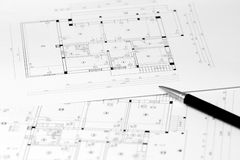 Family house blueprint. Blueprint project papers of a family house stock images