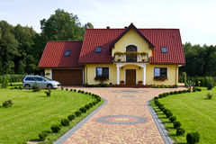 Family house with car. Elegant modern house with gardens and a parked car. Poland architecture Stock Photo