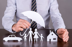 Family, house and car insurance concept Stock Photos