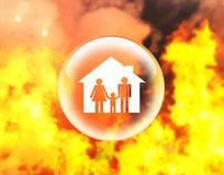 Family and house in crystal ball on fire. Insurance concept Stock Photos