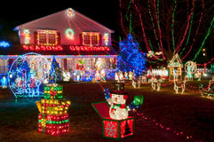 Family house decorated for Christmas celebration. Upscale family house with large lawn decorated with Christmas decoration and lights Stock Photo