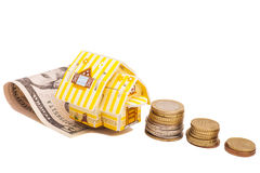 Family House with Dollars and Euro coins Royalty Free Stock Photos