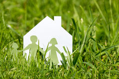 Family with house in a green grass stock photo