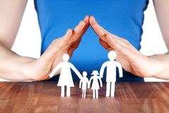 Family with house of hands. A family standing under a roof of a house build of hands Stock Image
