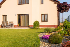 Family house with a lawn and spring garden Stock Photo