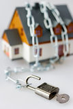 Family house and metallic chain as a protection Royalty Free Stock Image