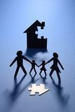 Family and house with missing jigsaw Royalty Free Stock Photography