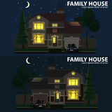 Family house at night. 2 houses, car and trees Stock Image