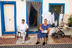 Family on house porch, La Vila Joiosa, Spain royalty free stock photography