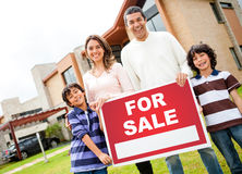 Family with house for sale Royalty Free Stock Image