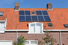 Family house with solar panel on the roof. Dutch Family house with solar panel on the roof Royalty Free Stock Image