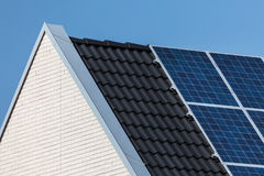 Family house with solar panels attached Stock Images