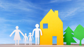 A Family With House and Trees. A Paper Family with their House and Trees in front of a blue Sky Royalty Free Stock Images