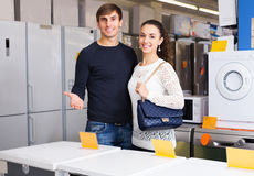 Family at household appliances store Stock Photo