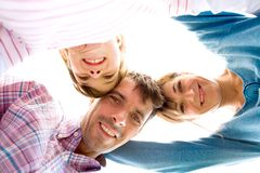Family in a huddle Royalty Free Stock Photos