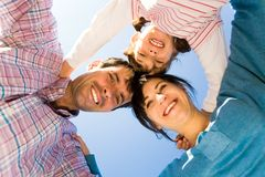Family in a huddle Royalty Free Stock Photo