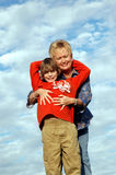 Family hug. A grandma and grandson hugging outdoors on a hill Stock Photos