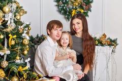 Family hug on Christmas. Royalty Free Stock Photo
