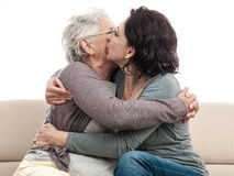 Family hug mother and daughter kiss Stock Photos