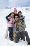 Family hugging outdoors in the snow Stock Images