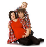 Family hugging pregnant mom Royalty Free Stock Photography