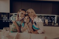 Family Hugs. Happy Family Cooking. Smiling Girls. Family Hugs. Happy Family Enjoy Cooking. Smiling Girls. Happy Family Cooking. Thanksgiving Day. Family royalty free stock photo