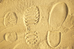 Family human footprints in the sand Stock Photos