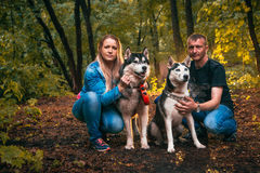 Family with husky dogs in the forest Royalty Free Stock Images