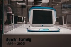 Family of iBooks on display inside Apple Museum in Prague, Czech Republic. Prague, Czech Republic - August 28, 2018: Family of iBooks on display inside Apple royalty free stock image