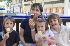 Family ice-cream. Mother and kids having ice-cream Stock Photos