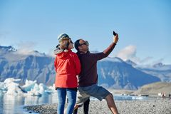 Family in Ice Lagoon in Iceland royalty free stock images