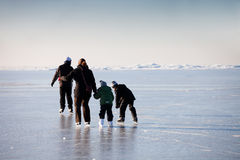 Family ice skating. In natural rink frozen sea Royalty Free Stock Photography