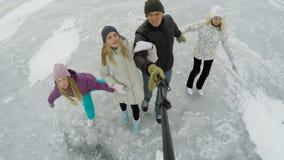 Family ice skating on frozen lake Royalty Free Stock Photo