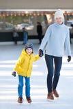 Family ice skating Royalty Free Stock Photos