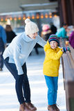 Family ice skating Stock Photography