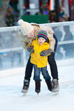 Family ice skating. Happy positive family of two ice skating at winter Stock Photos
