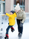 Family ice skating Royalty Free Stock Photography