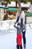 Family ice skating Stock Photos