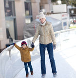Family ice skating Royalty Free Stock Photo