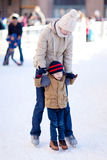 Family ice skating. Family of two enjoying winter ice skating together Royalty Free Stock Photography
