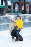 Family ice skating Stock Images